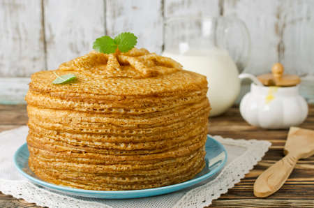 shrove tuesday: A stack of pancakes on a wooden table. Shrove Tuesday