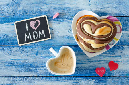 meal: Breakfast with coffee and bun Heart. Letter I love mom. Mothers day