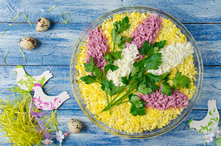 lilac: Salad with chicken and mushrooms decorated with sprigs of lilac. Flowers made of egg colored by beet juice