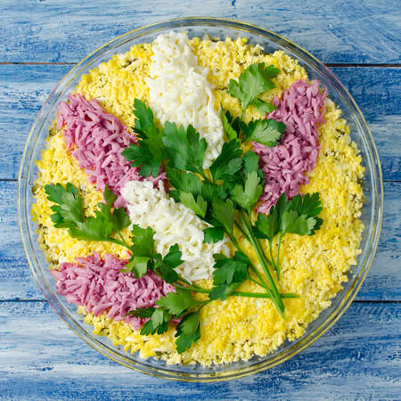 beet juice: Salad with chicken and mushrooms decorated with sprigs of lilac. Flowers made of egg colored by beet juice