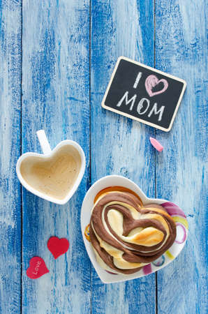 Breakfast with coffee and bun Heart. Letter I love mom. Mothers day