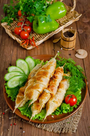barbecuing: Kebab with tomatoes and cheese in pastry. Barbecuing lunch
