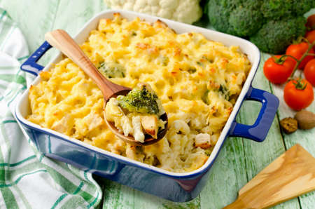 baked meat: Casserole with pasta, chicken, broccoli and Bechamel sauce under a cheese crust
