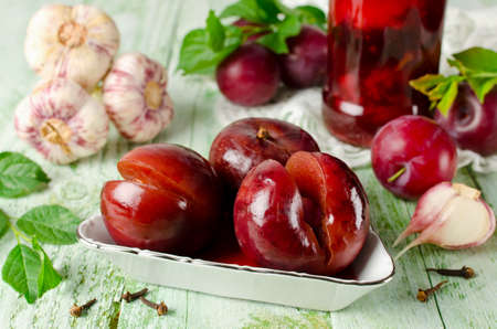 Pickled plum with garlic. Home canning