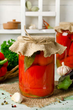 Peppers stuffed with eggplant. Home canning Stock Photo