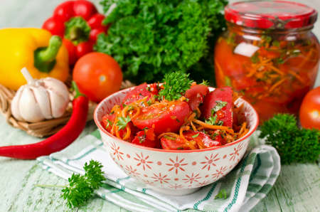 Fresh tomatoes, carrots, bell pepper and spices, homemade pickled vegetables Stock Photo