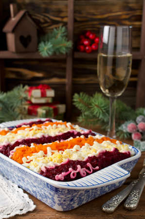 Traditional Russian salad Herring under a fur coat. Layered salad with herring and vegetables