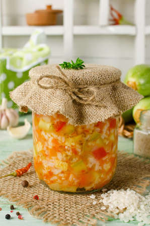 canning: Rice with vegetables - zucchini, paprika and onions. Home canning