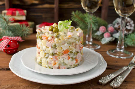 cookware: Russian traditional salad Olivier with vegetables and meat. Winter Christmas salad Stock Photo