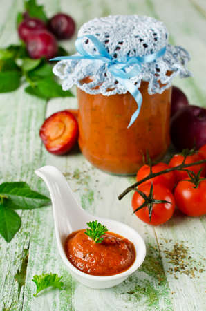 Tomato ketchup sauce with garlic, spices and plums. Home canning