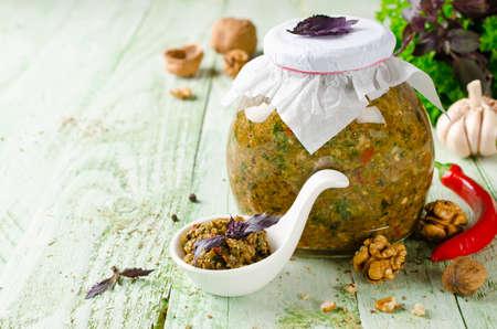 tabasco: Homemade sauce adjika with hot pepper, garlic, basil, parsley and walnuts. Tabasco Stock Photo