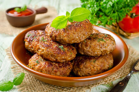 Homemade cutlets with oatmeal on a wooden table in a rustic style. Healthy food Stock Photo