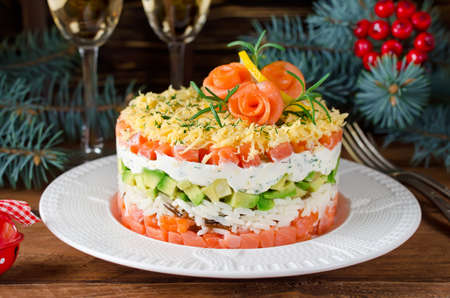 Layered salad with salmon, avocado and cream cheese. Salad for the holiday table
