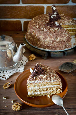 honey cake: Sweet homemade honey cake with with walnuts and grated chocolate