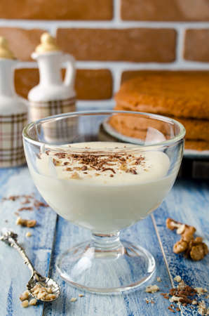 condensed: Yogurt cream for cake with chocolate and nut crumbs. Selective focus