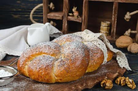 Yeast roll Braid. Baking with poppy seeds, nuts and raisins Stock Photo