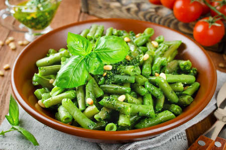 Green beans with pesto and pine nuts. Delicious balanced food concept