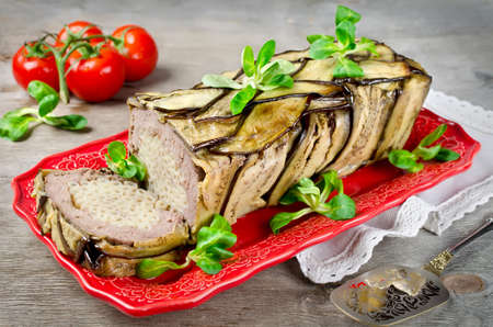 Terrine - casserole of meat, vegetables and pasta. Oven Baked meatloaf.