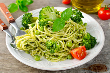 Spaghetti with green peas and basil pesto. Delicious balanced food concept