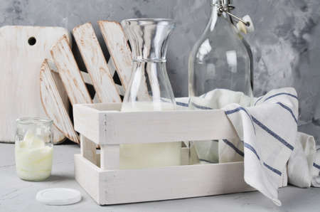 Jars and bottles in the boxes. Kitchenware