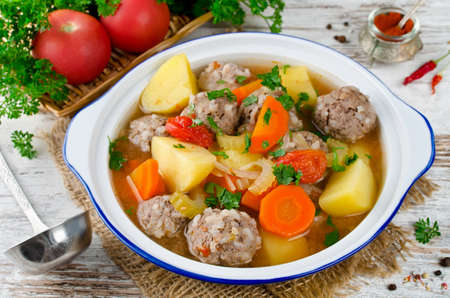 Meatballs in a thick vegetable soup Albondigas. Mexican and Spanish cuisine