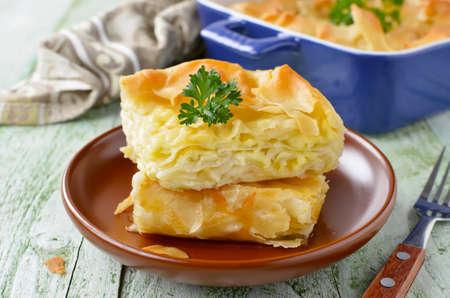 Cheese puff pie from unleavened dough. Georgian cuisine - khachapuri Achma