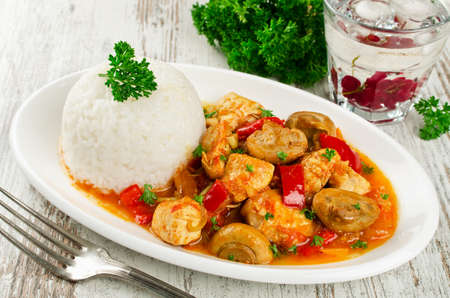 Chicken stew with mushrooms served  with rice. Healthy and low calorie food Zdjęcie Seryjne - 89489887