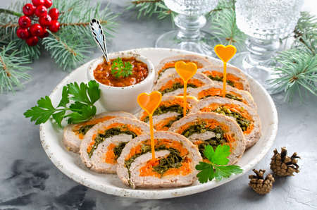 Meatloaf with parsley, cheese and carrots. New years appetizer Stock Photo