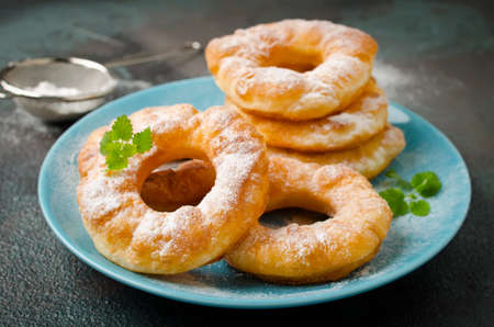 Homemade fried vanilla cottage cheese donuts with icing sugar