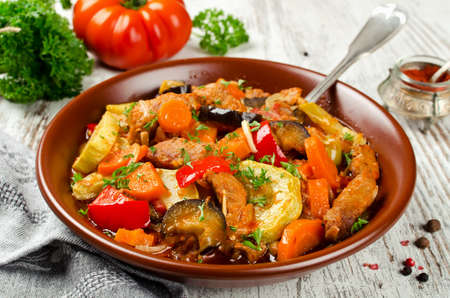 Meat stew with eggplant, carrots, onions, peppers and zucchini. Healthy and low calorie food