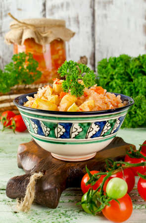Salad with zucchini, rice and paprika. Homemade canning winter preserve