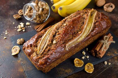 Homemade banana bread with walnut and cinnamon on a stone background Reklamní fotografie