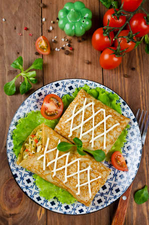 Crepes stuffed with stewed cabbage with carrots and eggs. Traditional Russian food. 免版税图像