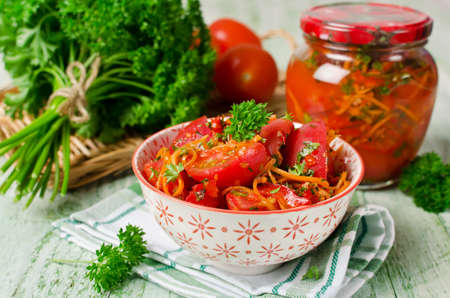 Fresh tomatoes, carrots, bell pepper and spices, homemade pickled vegetables
