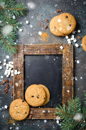 Background with chalkboard, homemade Chocolate Chip Cookies and marshmallows. Flat lay, space