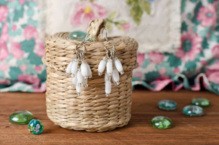 Handmade earrings made of small and large beads. Home workshop
