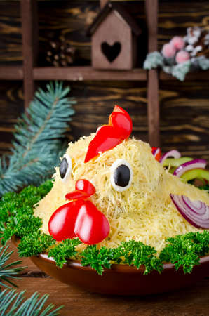 Salad shaped rooster for the New Year 2017. Attractive and fun food