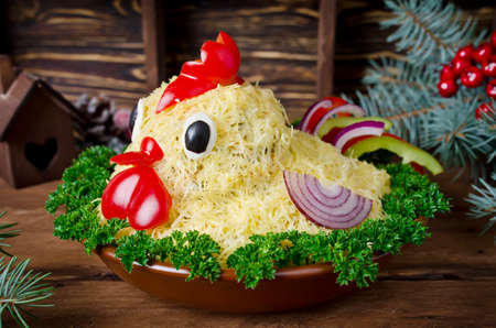 Salad shaped cock for the New Year 2017. Attractive and fun food