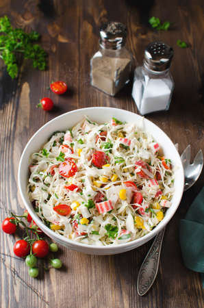 Salad with crab sticks, cabbage and tomatoes. Fresh delicious salad