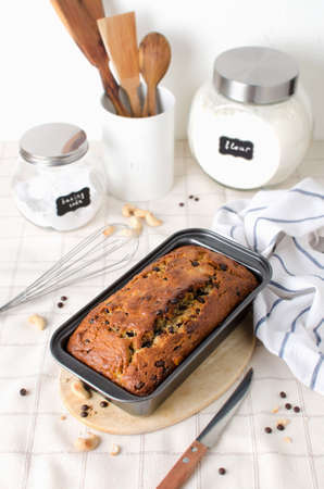 Homemade banana bread with cashew nuts and chocolate drops. Scandinavian style in cooking Stock Photo