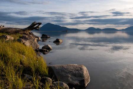 Calm ocean at Stikine river delta near Wrangell, Alaska in the evening