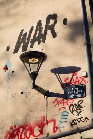 War graffiti france lamp shadow