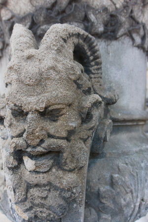 Demon Carving Face old and weathered
