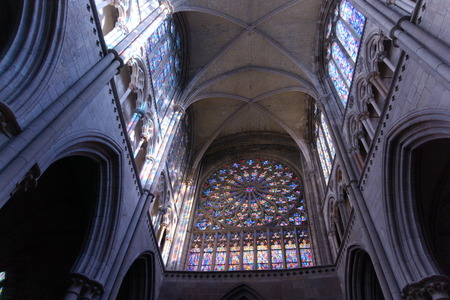 Looking up at arched ceilings in old cathedral, Saint Vincent of Saint-Malo. Light shining through stained glass arches inspiring holy Editoriali