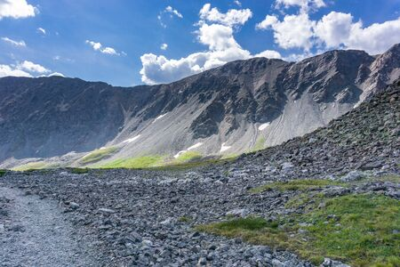 Talus and broken rocks line alpine trail up to Gray's Peak, Colorado Stock fotó