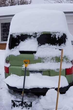 Shoveling car out of driveway