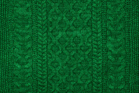 Green knitting texture. Knitted Background.
