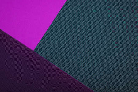 Abstract geometric paper background. Purple, pink, grey and violet trendy colors. Geometric vibrant colors textured flat lay.