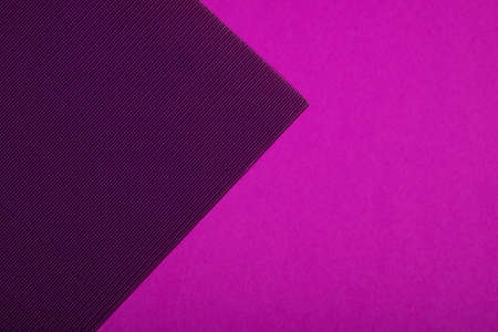 Abstract geometric paper background. Purple, pink and violet trendy colors. Geometric vibrant colors textured flat lay. Stock Photo