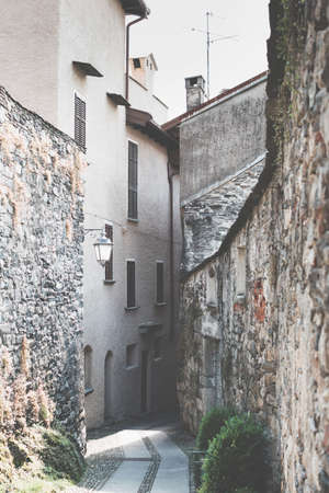 Picturesque Italian narrow street in Orta San Giulio town. Tourist destination.